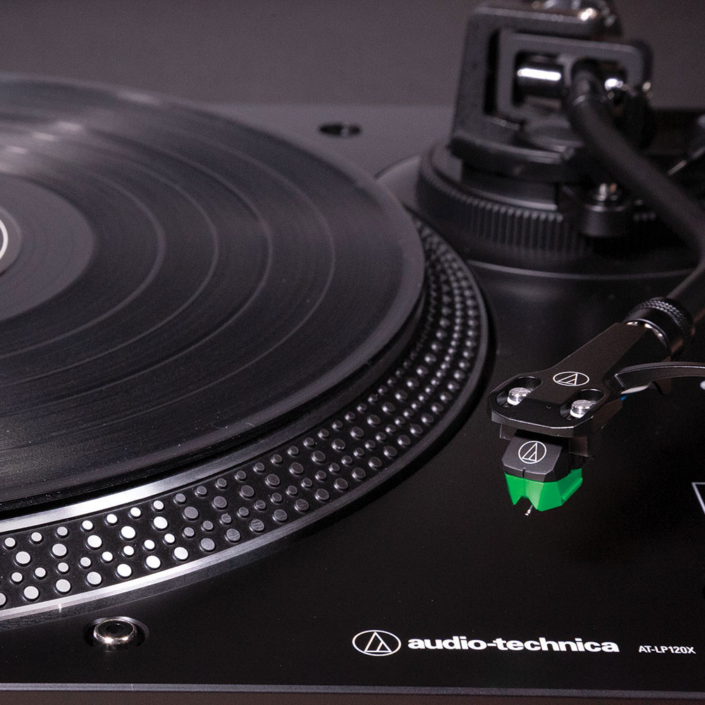 Audio-Technica AT-LP120XUSBBK Turntable - Arm on the Stand