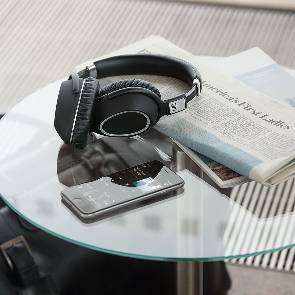 Sennheiser PXC 550 Wireless Headset - On the Table with a Phone